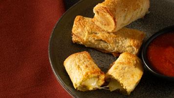 Rouleaux de fromage fondu au pesto