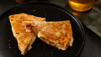 Sweet and Spicy Pear and Prosciutto Quesadillas